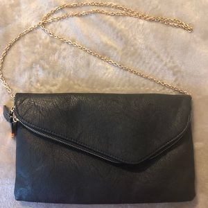 Black clutch with gold cross body chain